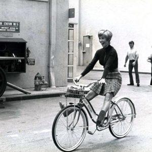Sandy Duncan rides a bike.