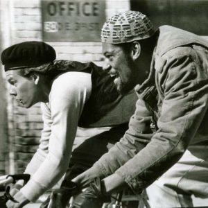 Kevin Bacon and Laurence Fishburne race bikes.