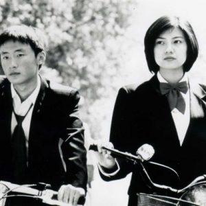 Li Bin and Gao Yuanyuahn ride bikes.