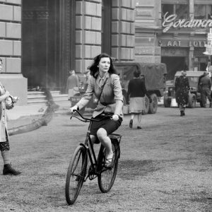 Cate Blanchett rides a bike. In 1945 Berlin.