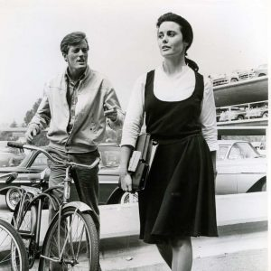 Peter Fonda walks into a bike. Sharon Hugueny is late… for class.