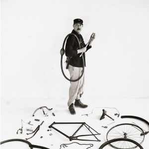 Jacques Tati assembles a bike.