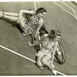 Ruth Martin and Peggy Calvin vogue around a bike.