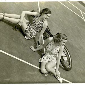Ruth Martin and Peggy Calvin vogue around a bike.