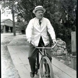 W. C. Fields rides a bike.