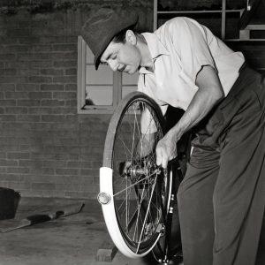 William Powell fixes a bike.