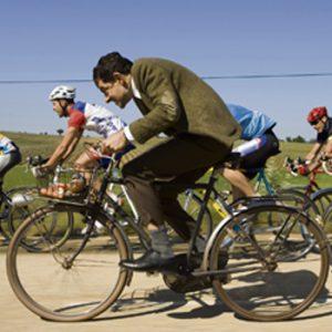 Rowan Atkinson rides a bike.