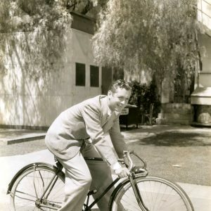 Robert Montgomery rides a bike. With drop bars.