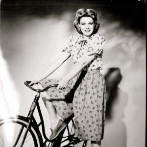 Marjorie Woodworth steps through a bike.