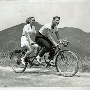 Ronald Reagan and Jane Wyman ride a bike.