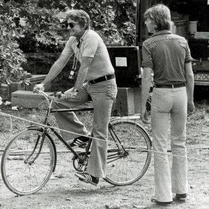 Blake Edwards rides a bike.