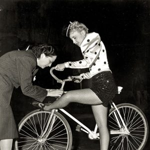 Susanna Foster holds a bike. And gets her fishnets fixed. See Foster and her cycling chorine co-stars on this Rides a Bike archive page.
