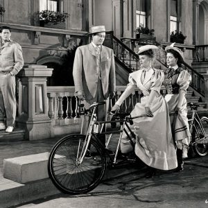 Janis Paige and Dorothy Malone ride a bike. Don DeFore and Dennis Morgan consider.