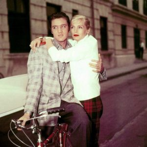 Elvis Presley sneers a bike. Lizabeth Scott hangs.