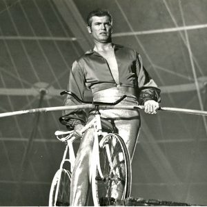 Ty Hardin rides a bike. And walks a rope.