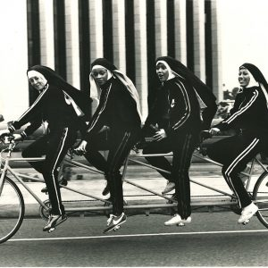 Americathon nuns ride a bike.