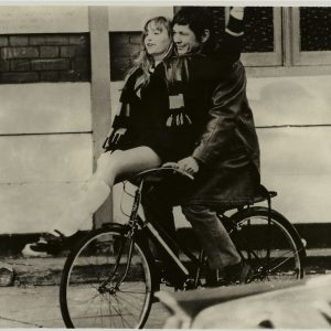Susan George and Charles Bronson ride a bike.