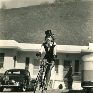 Dorothy Moore rides a bike. And wears a hat.
