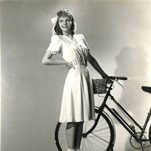 Mary Martin tiptoes a bike.