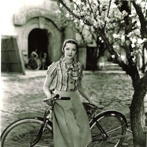 Sylvia Sidney rests on a bike.