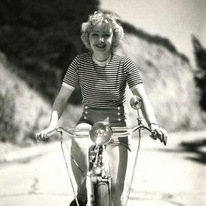 Alice White rides a bike.
