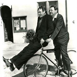 Gary Cooper and Babe Ruth ride a bike.