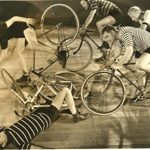 """6 Day Bike Rider"" track cyclists and stunt riders ride bikes, crash bikes. Note: This is a production still from ""6 Day Bike Rider,"" the 1934 Joe E. Brown velodrome-set comedy. If you can identify these riders, please let us know at ridesbike@gmail.com (no ""a""). Many Olympic and competitive cyclists of the day appeared in the film."