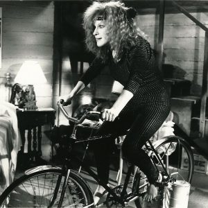 Bette Midler rides a bike. Ruthlessly.