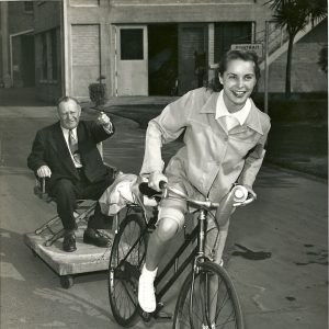 Janet Leigh rides a bike, and tows Arthur Rosenstein.
