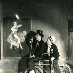 Ollie and Johnson ride a bike. And appreciate art.