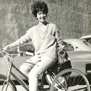 Suzanne Pleshette and Missy ride a trike.