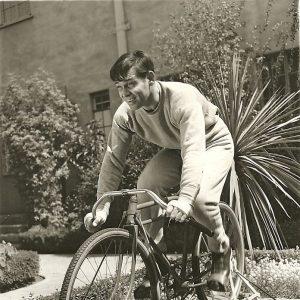 Clark Gable rides a bike. Stationarily.
