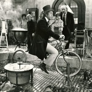 Gene Wilder rides a bike. In springtime, the only pretty ring time.