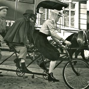 Gil Perkins, Lou Costello and Judith Brian ride a bike. Happy Halloween.