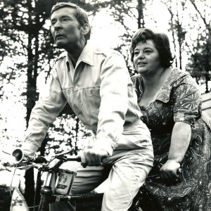 Kenneth Williams and Hattie Jacques ride a bike.