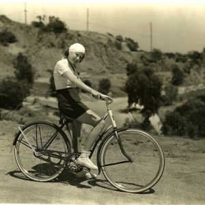 "Barbara Weeks rides a bike. Snipe: Barbara Weeks, Columbia contract player, goes for a jaunt on her new bicycle in Laurel Canyon, adjoining Hollywood. She is ideally garbed for this very active sport. Miss Weeks' most recent picture is ""Rusty Rides Alone,"" opposite Tim McCoy."