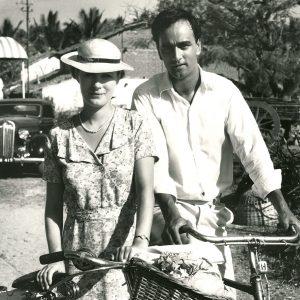 Susan Wooldridge and Art Malik walk bikes.