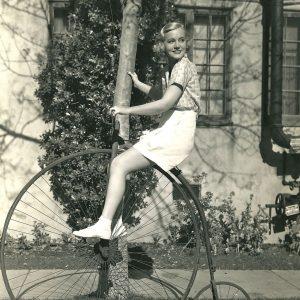 Shirley Grey rides a bike.