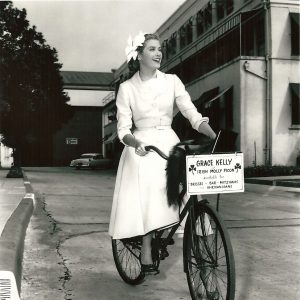 Grace Kelly rides a bike.