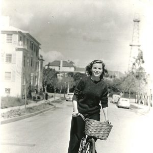Dorothy McGuire rides a bike.
