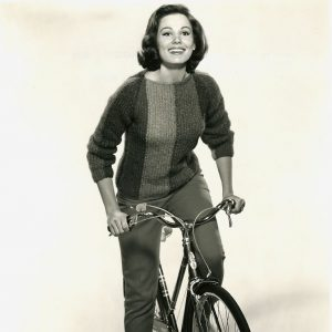 Paula Prentiss rides a bike. (Miss Prentiss' outfit by Pantino's.)