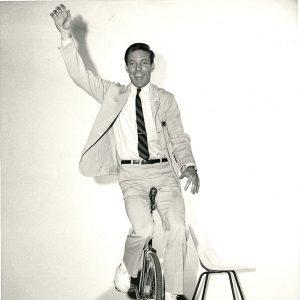 Richard Chamberlain rides a unicycle.
