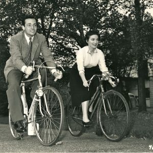 David Knight and Margo Lorenz ride bikes.