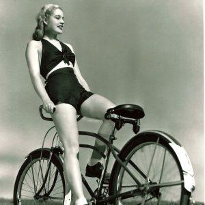 Mary Beth Hughes rides a bike. Backwards.