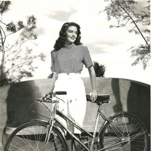 Dorothy Malone walks a bike.