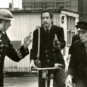Donald Sutherland rides a bike.