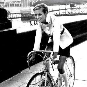 Twiggy rides a bike.