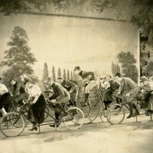Chester Conklin, Douglas Fairbanks Jr., Chester Morris, Gertrude Olmstead and Sally Eilers ride bikes.