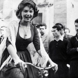 Sylvia Koscina rides a bike.