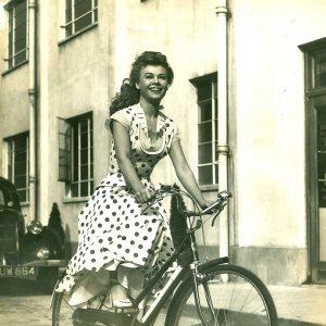 Vera-Ellen rides a bike.
